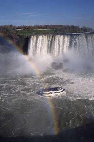 Niagara Falls - New York and Ontario - with a rainbow and the Maid of the Mist