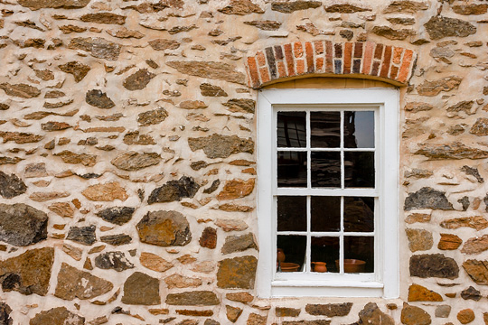 Window on a Stone Wall at Old Salem Museum in Winston-Salem, North Carolina